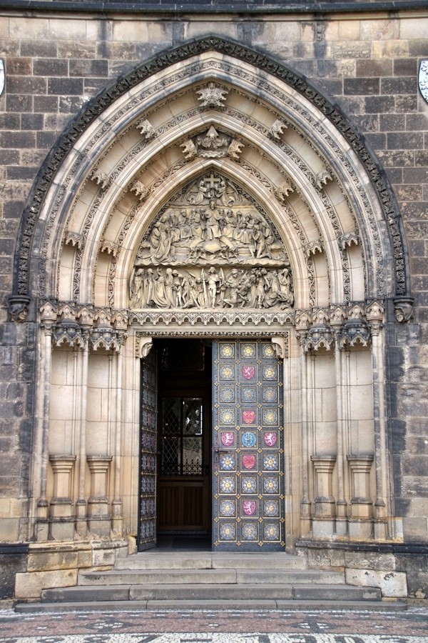 ornate entrance to an old church in Prague