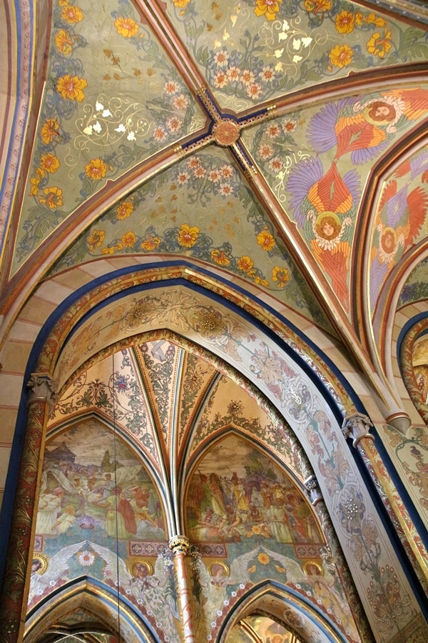 brightly painted vaulted ceilings inside church