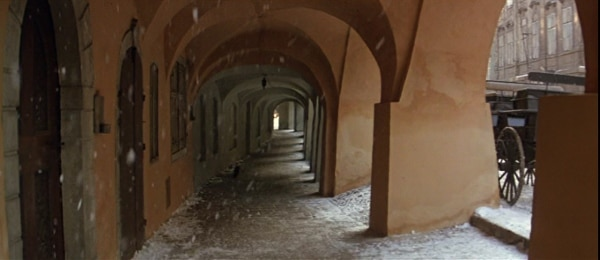 screenshot from the film Amadeus of a snow-covered walkway