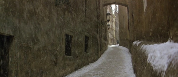 screenshot from the film Amadeus of a snow covered narrow street