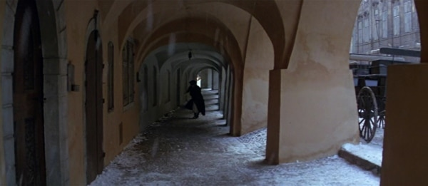 screenshot from the film Amadeus of a man walking in the snow