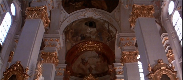 a screenshot from the movie Amadeus of the inside of a church