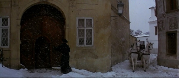 screenshot from the movie Amadeus of a house surrounded in snow