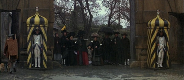 screenshot from the film Amadeus of a crowd standing in the rain
