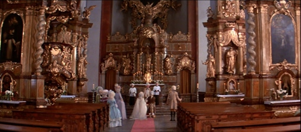 a screenshot from the movie Amadeus of a wedding in a church