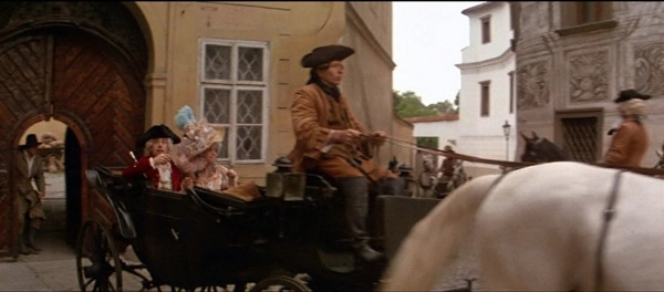 screenshot from the movie Amadeus of a horse drawn carriage
