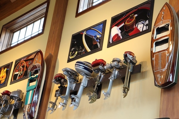 boat motors hanging from a wall