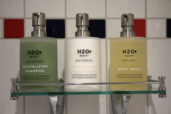 bottles of shampoo, conditioner, and body wash
