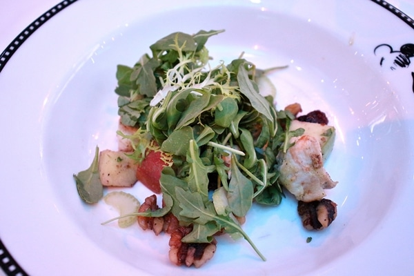 salad with walnuts on a white plate