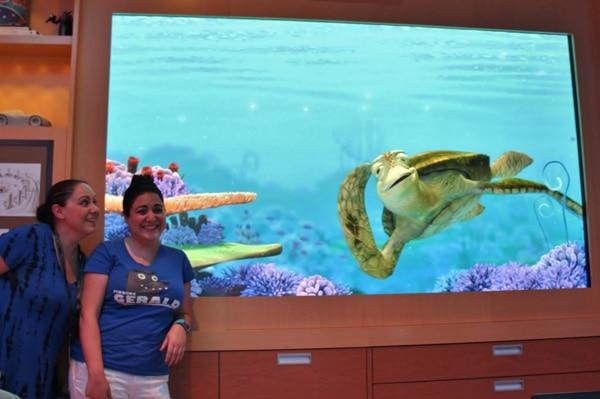 2 women posing with Crush from Finding Nemo
