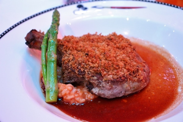 crusted meat with tomato risotto and brown sauce