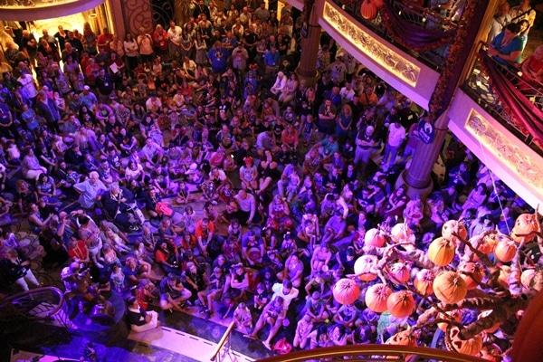 a crowd of people in the Disney Fantasy atrium