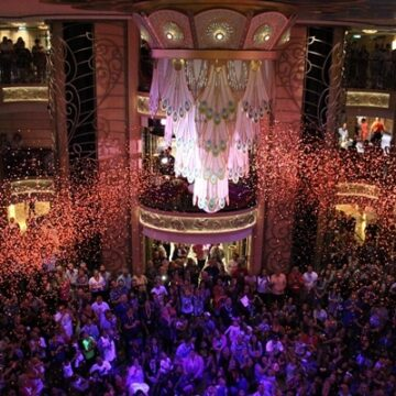 The atrium of the Disney Fantasy with confetti falling in honor of Halloween