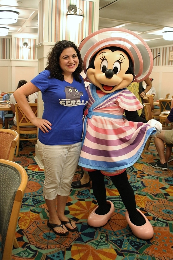 a woman posing with Minnie Mouse
