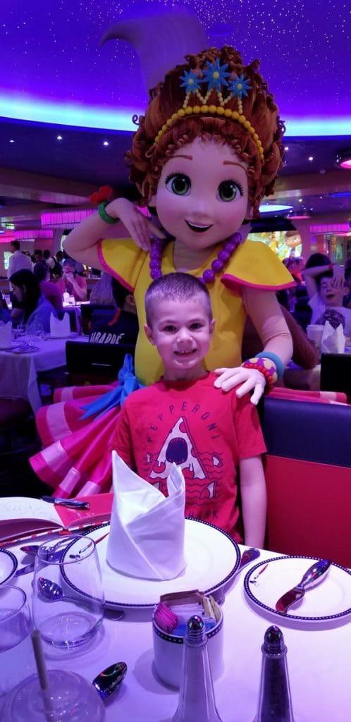 a boy posing with Princess Sophia from Disney Junior
