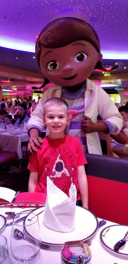 a boy posing with Doc McStuffins