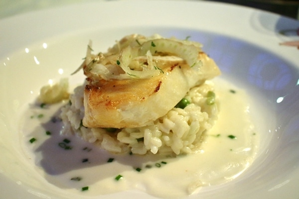fish filet over risotto with peas
