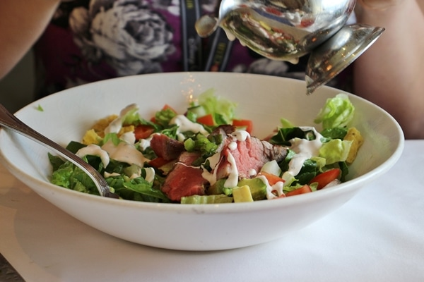 A bowl of steak salad