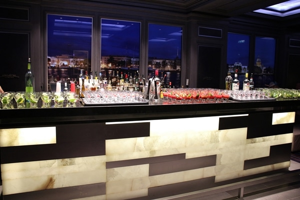 a bar topped with various glasses