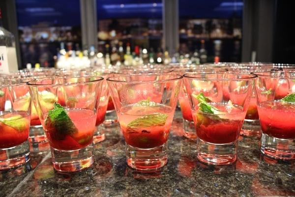 glasses of partially made raspberry mojitos