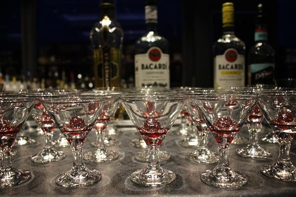 small cocktail glasses with cherry garnishes