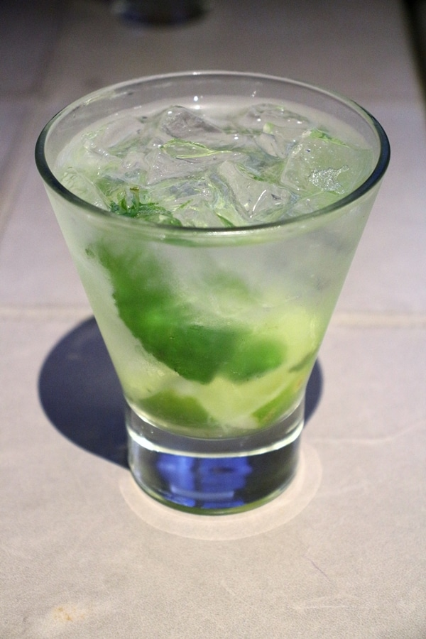 A close up of a mojito cocktail