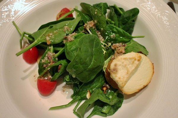 A small salad with a goat cheese toast