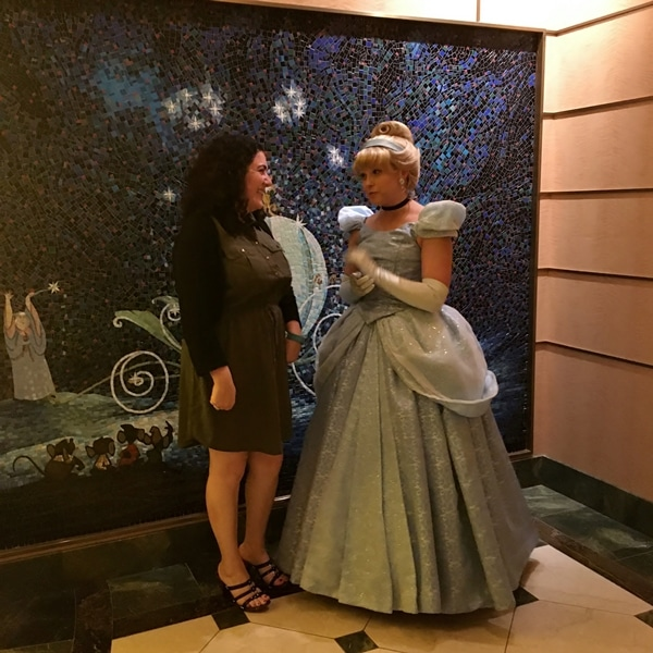 A woman posing with Cinderella