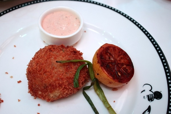 a crab cake with grilled lemon
