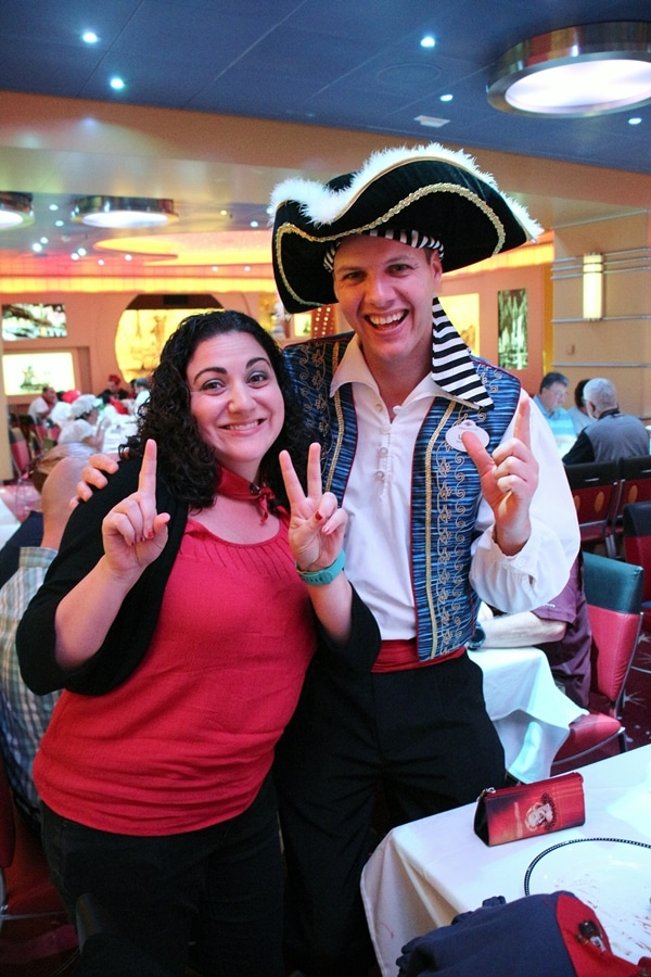 A woman posing with a man dressed as a pirate