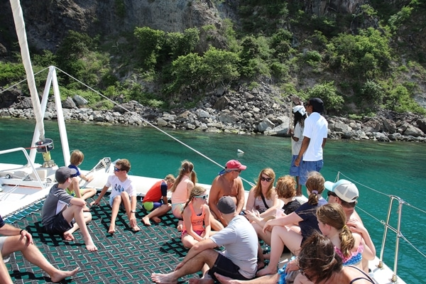 A group of people on a catamaran in the Caribbean
