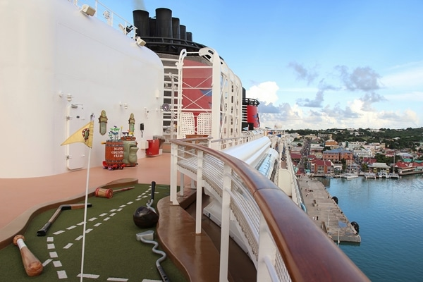 the mini golf area on the Disney Fantasy cruise ship while docked at port