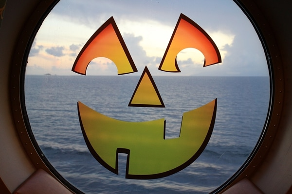 A view of a body of water through a jack-o-lantern window decal