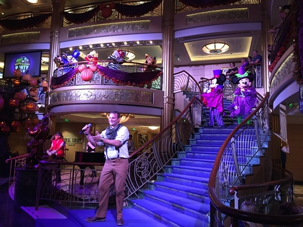 Mickey and Minnie Mouse in Halloween costumes in the Disney Fantasy atrium