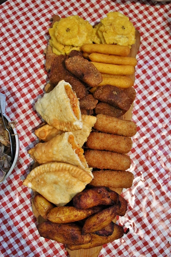 a variety of fried Puerto Rican foods on a platter