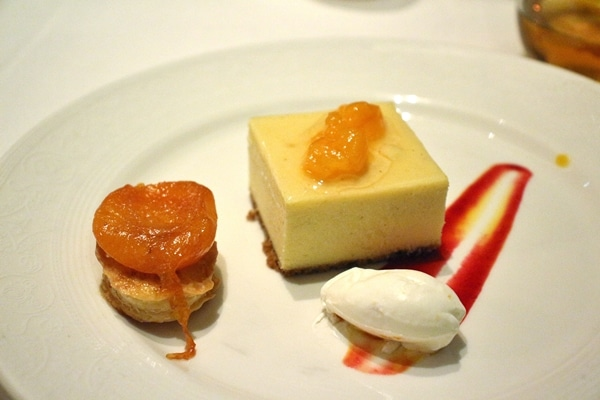 a trio of apricot desserts on a white plate