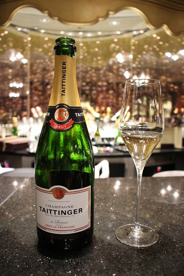 A close up of a bottle of Champagne on the bar