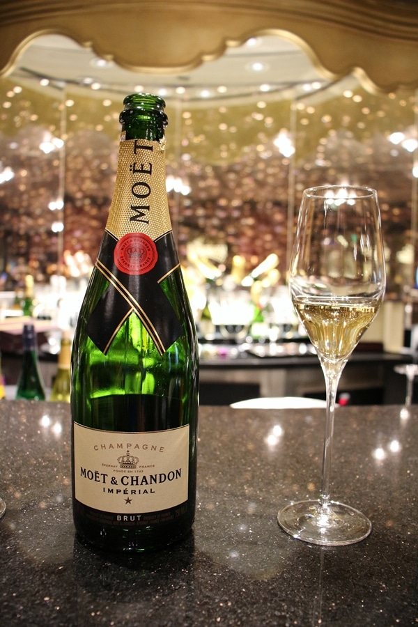 a bottle and glass of Champagne