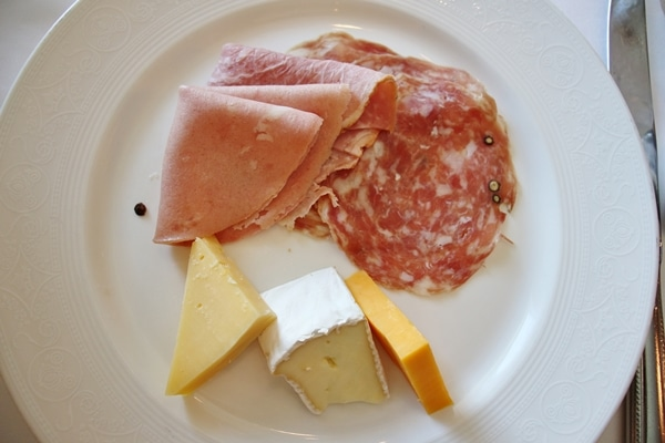 cold cuts and cheeses on a white plate