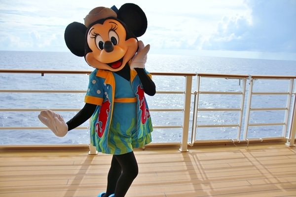 Minnie Mouse wearing her bathing suit on the deck of a cruise ship
