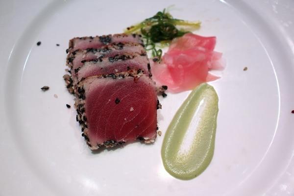 seared tuna with wasabi on a white plate