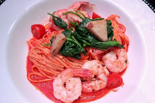 linguine with seafood and spinach in a wide bowl