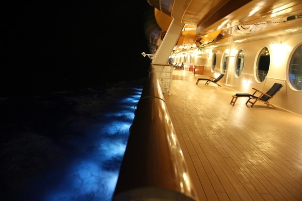 the deck of a cruise ship at night