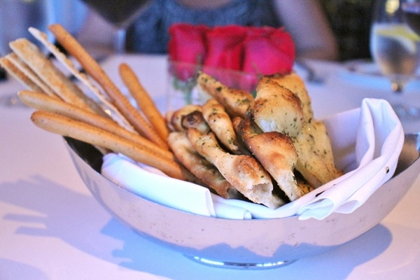 a platter of various breads and breadsticks