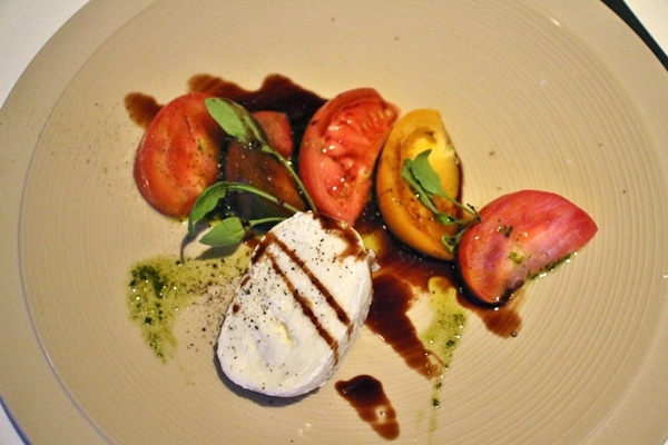 mozzarella and tomatoes with balsamic on a plate