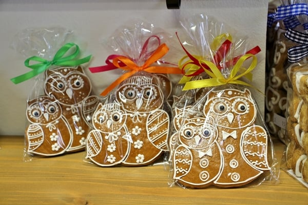 owl shaped gingerbread cookies for sale in a shop