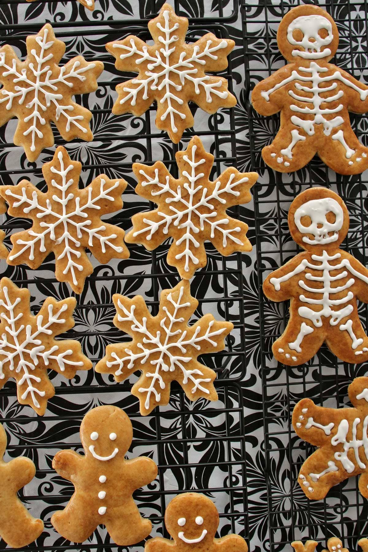 Czech gingerbread cookies decorated with royal icing on a cooling rack.