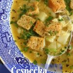 a bowl of cesnecka (Czech garlic soup) with rye croutons in a wide blue bowl