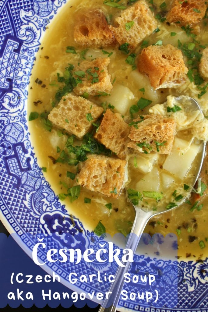 A bowl of Czech garlic soup with rye bread croutons