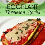 Two white plates, each with a stack of eggplant with tomato sauce and cheese